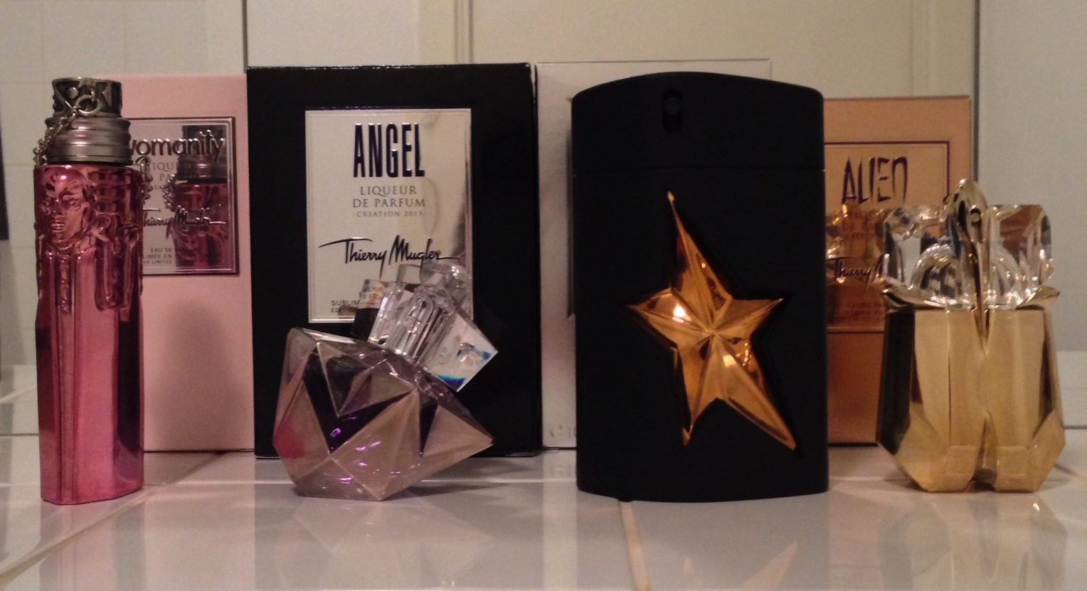 Womanity liqueur de parfum the candy perfume boy for Thierry mugler a travers le miroir