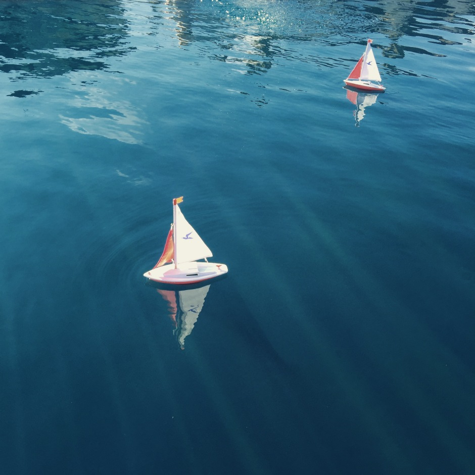 """Toy boats on a toy lake. Chlorine brings back memories of summer swimming lessons and endless hours in the water."""