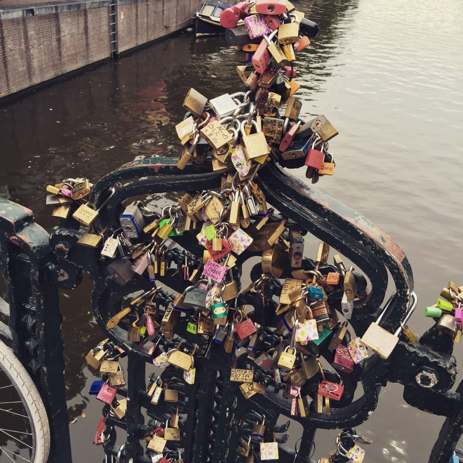 """Lovers' locks on one of #Amsterdam's many bridges. The smell of bronze, rusty metal and marker pen, with a whiff of green canal in the background #ScentedStories"""